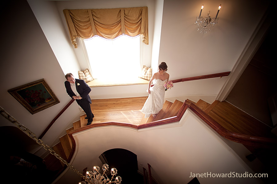 Bride and groom part on Wimbish House staircase