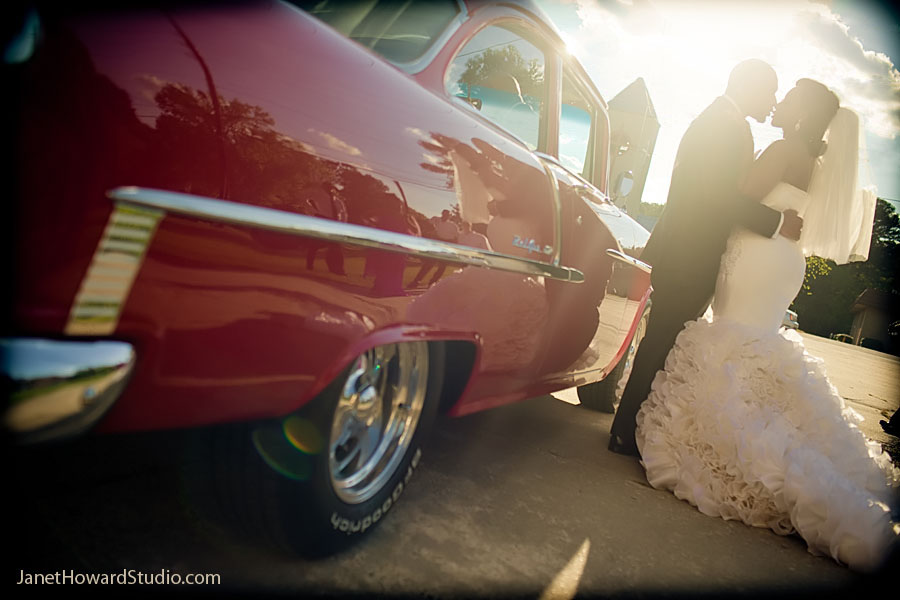 Bride and Groom with Red classic car