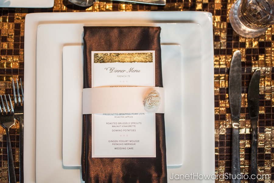 Square plates on gold and brown square linen