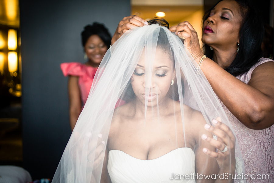 Bride's mother puts on veil
