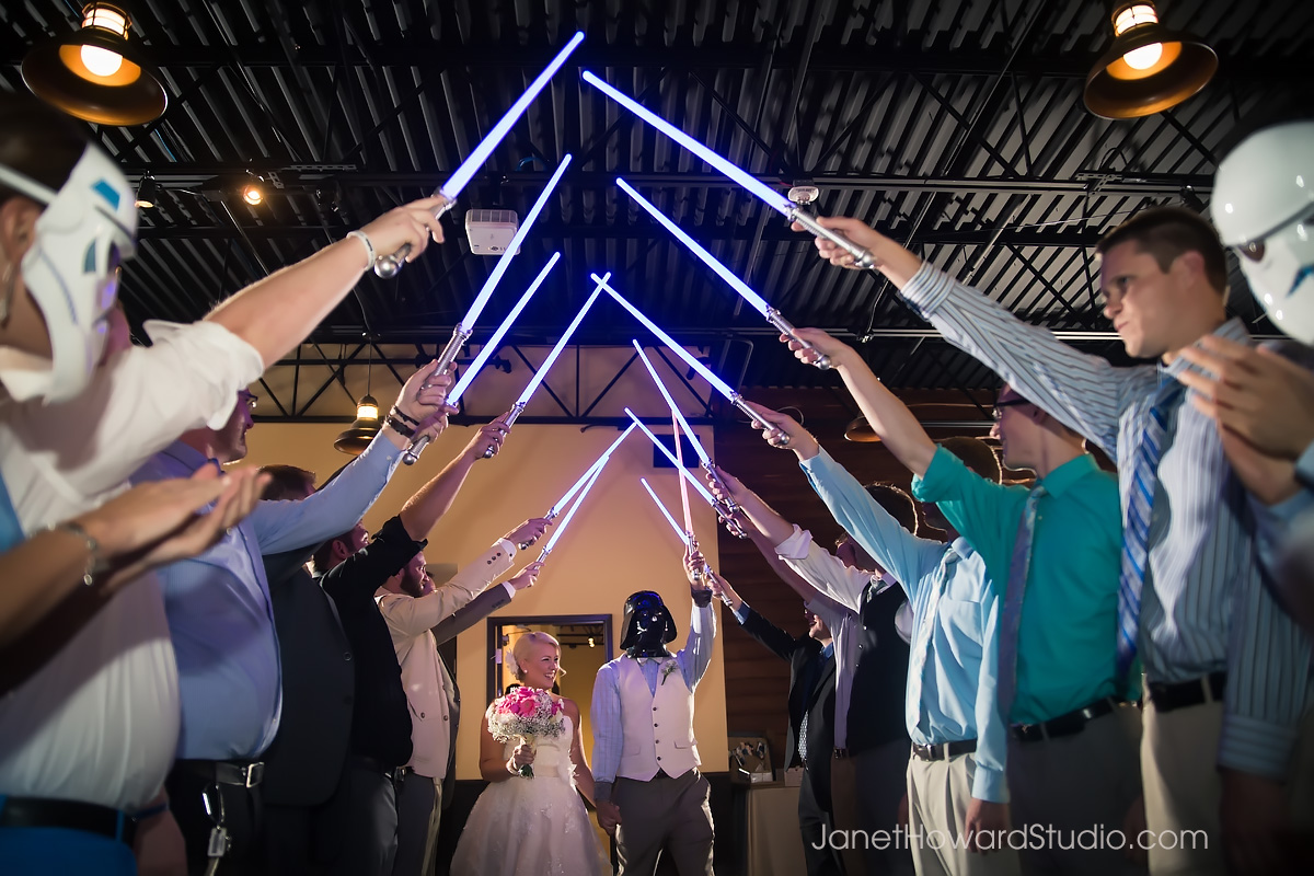 Wedding reception entrance through lightsaber arch