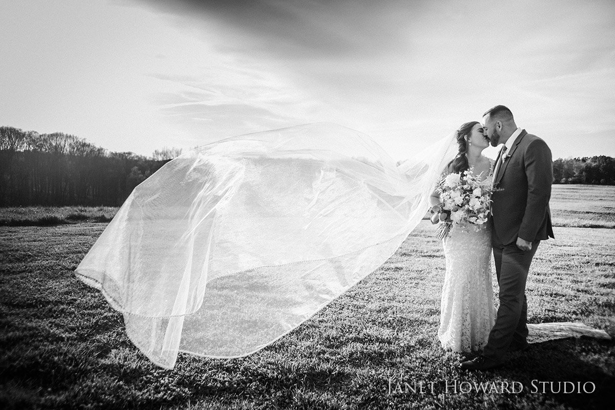 bride and groom and veil at West Milford Farm