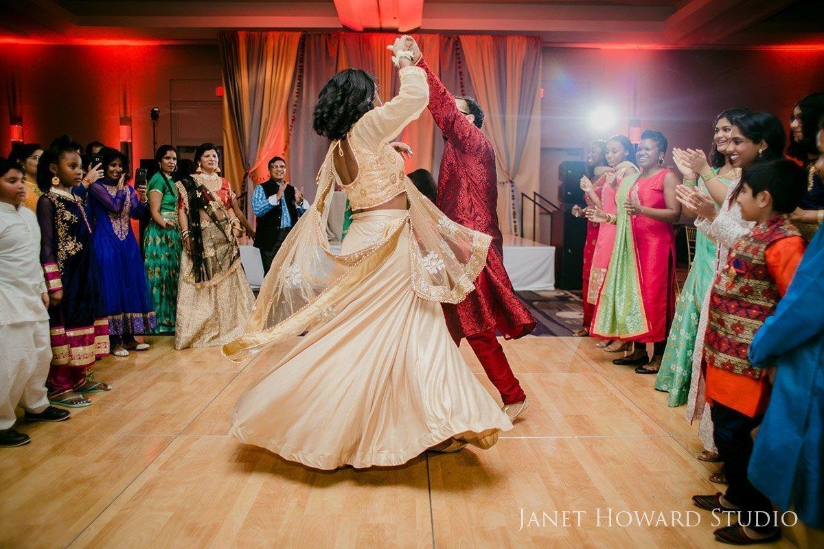bride and groom dancing at Sangeet