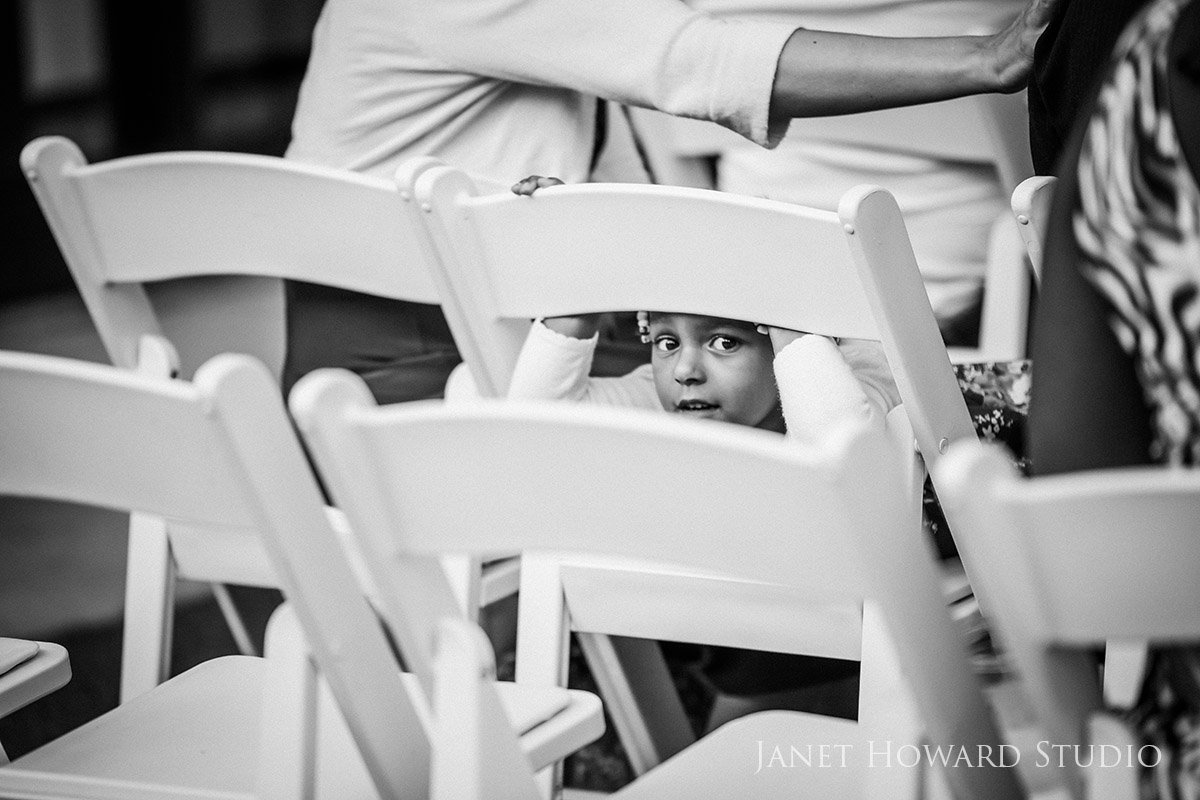 Little Boy Hiding During Wedding Ceremony