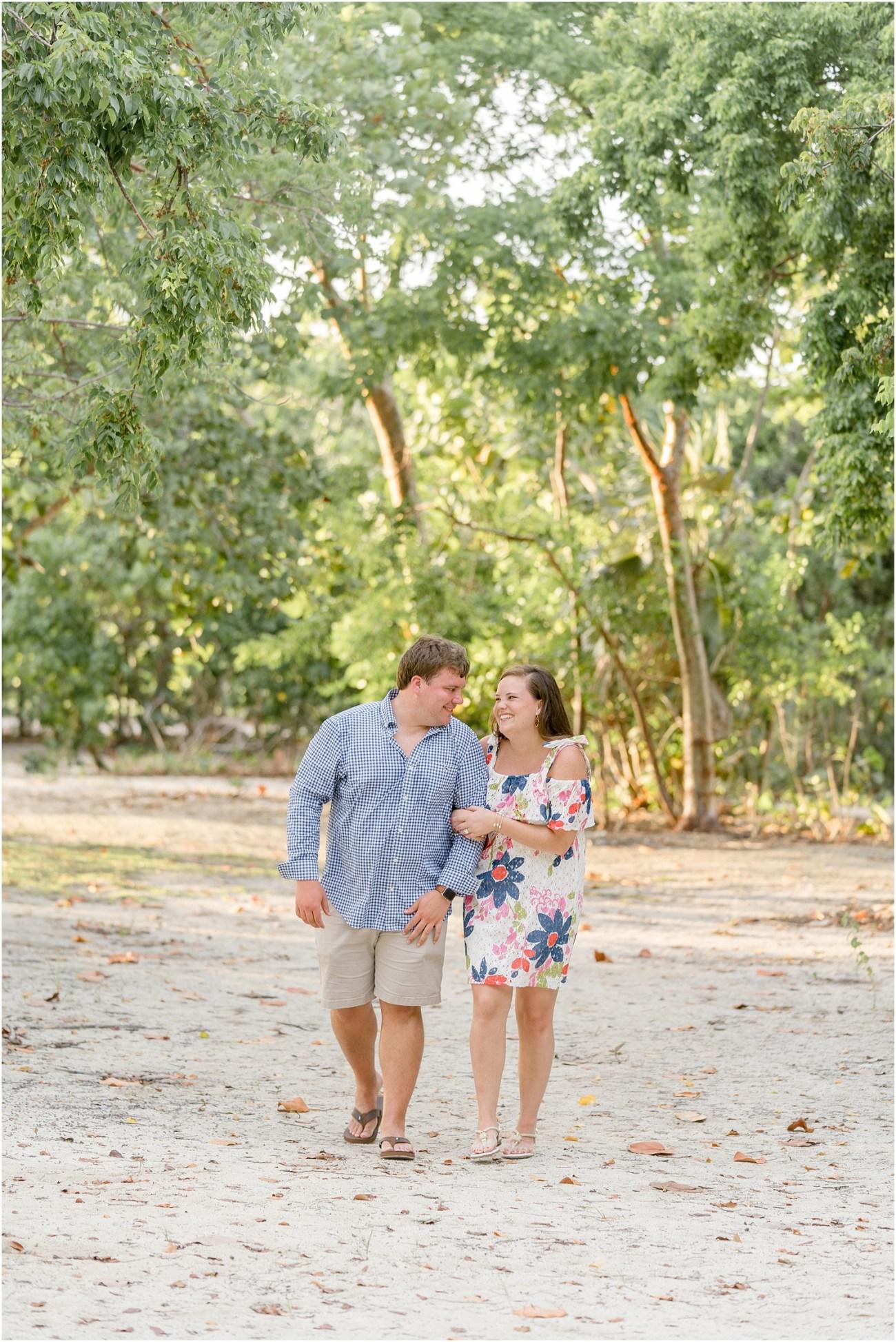 beach surprise engagement grand cayman couple walking