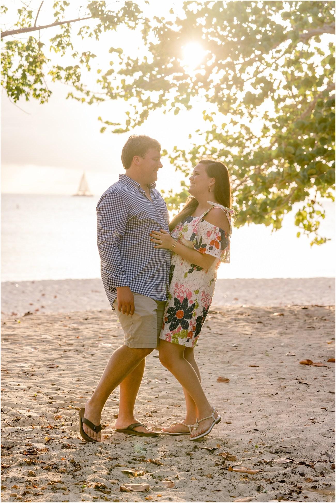 beach surprise engagement grand cayman happy couple