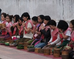 People waiting to feed the monks in Luang Prabang