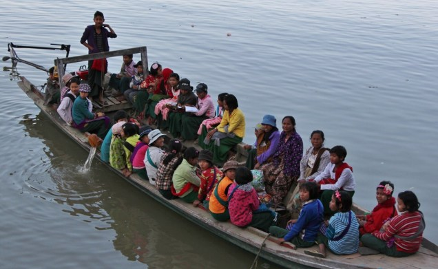 Kids being taken back to their villages after school in Shwego.