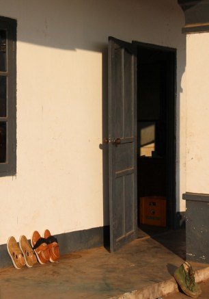 Door with shoes outside