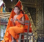 Wat Xieng Thong -- novice monk -- notice ear bud