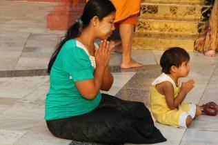 Woman and child praying