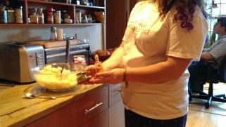 Sarah works on the potatoes