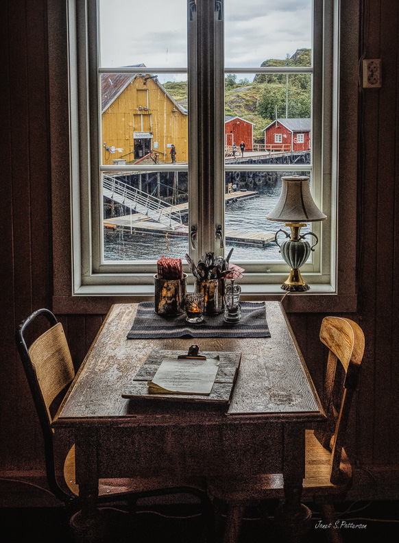 Cityscape, Nusfjord, harbour, restaurant, interior, window, seascape. Norway