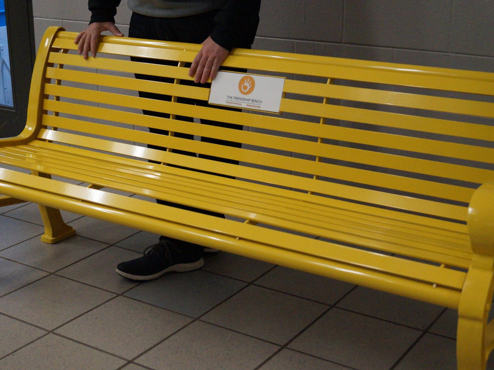 yellow friendship bench