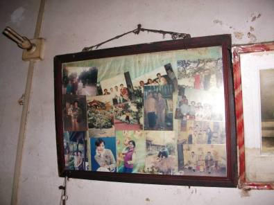 On the wall hung a collage of photos of relatives from Malaysia and Singapore.