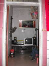 An extension has been built in the old house. There are television and stereo in the house.