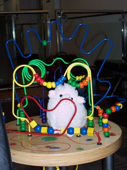 Stuffed sheep in a Busy Beads toy