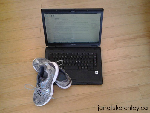 Sneakers resting on a laptop computer.
