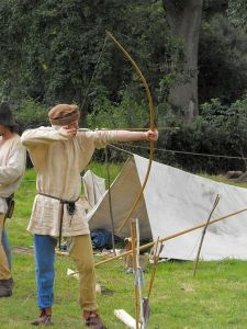 Member of The Montgomery Levy displaying archery in mediaeval times; photograph by Penny Mayes; License via Wikimedia Commons
