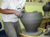 Giorgios demonstrates making a large pot 6. Refining the rim