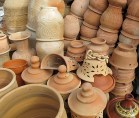 Pots piled in the yard.