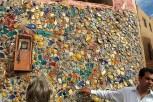 A wall mosaic of broken pottery.
