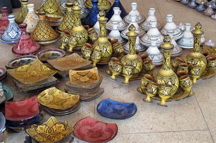 Beautifully decorated tajines, plates, and goblet and carafe sets..