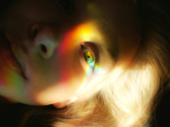 woman's face glowing with light