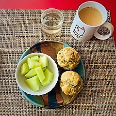 sun butter muffins for breakfast with honeydew melon and coffee