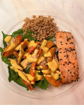 roasted salmon fillet on bed of spinach with roasted root veggies and farro