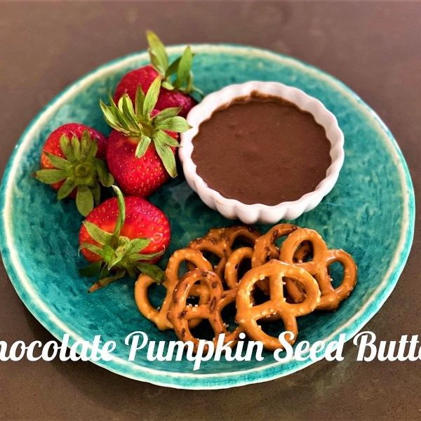 chocolate pumpkin seeds butter with strawberries and pretzels