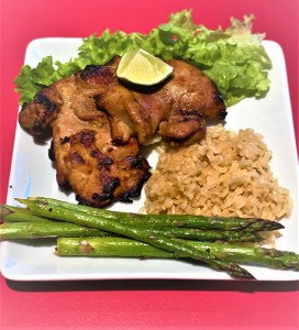 Grilled boneless chicken thighs with rice and asparagus