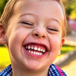 Young boy with huge smile