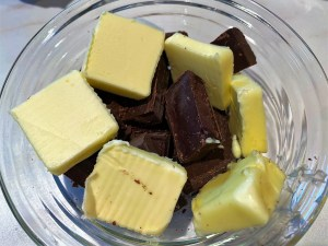 bowl of butter chunks and chocolate chunks to melt for carb-conscious erythritol brownies