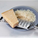 chunk of Parmesan cheese with grater