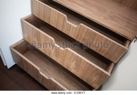 open-wooden-drawers-in-close-up-e1dkyt