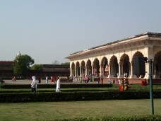 Visitors strolling through the gardens near the Hall of Public Residence