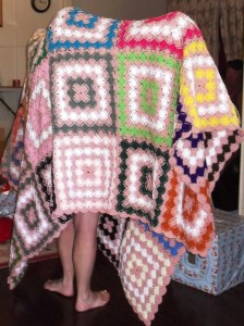 A queen-sized, handmade crochet blanket