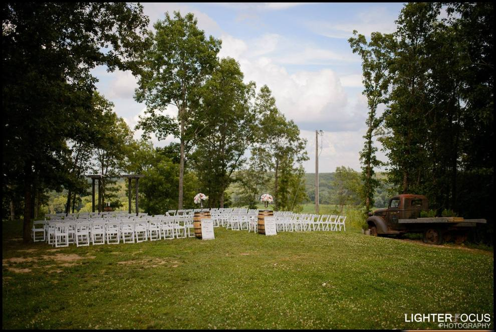 outside wedding, wine barrels, fresh flowers, ceremony, wedding flowers, ceremony to centerpiece, janine's flowers, wedding flowers, camdenton, lake ozark, osage beach, weddings, lake of the ozarks