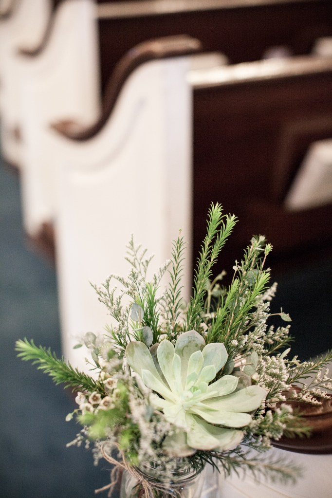 ceremony flowers, lake of the ozarks, pew flowers, succulents, wedding flowers,