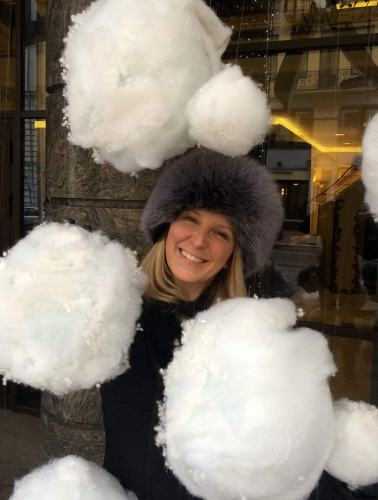 Janine Warner stops to play with the snowflakes on a trip to Kiev, Ukraine.