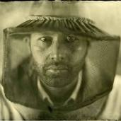 Portrait of Osheen Harruthoonyan (with beekeeper hat).