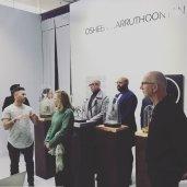Osheen Harruthoonyan speaks to guests. Photography Exhibit