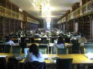 Students busily working in the library of the University of Santiago de Compostela. Note that there are no books in the shelves. That is because the library had just been renovated and the books have not yet been put back.