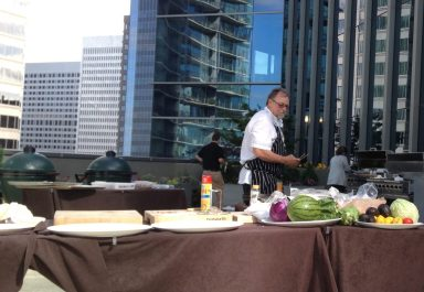 Amidst wind-blown napkins and the occasional flying aluminum pan, Chef Mark Shepherd shared grilling tips on his session at the Atlanta Food and Wine Festival. He cut that watermelon into large slices and threw it right on one of those Big Green Eggs.