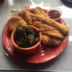 The fried catfish plate at Mama J's Kitchen, served with a side of greens and the best corn muffin that I regret sharing with my husband.