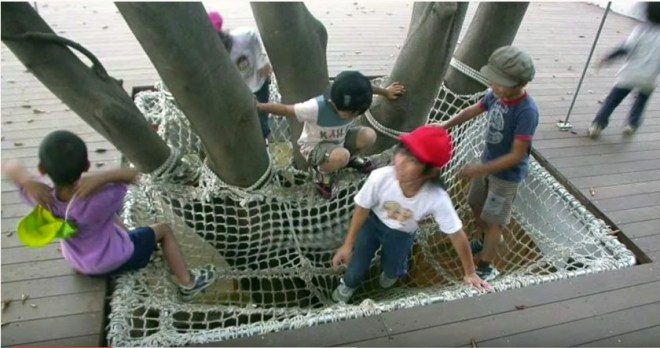One favorite activity at Fuji School is climbing on the tree with the cargo nets.