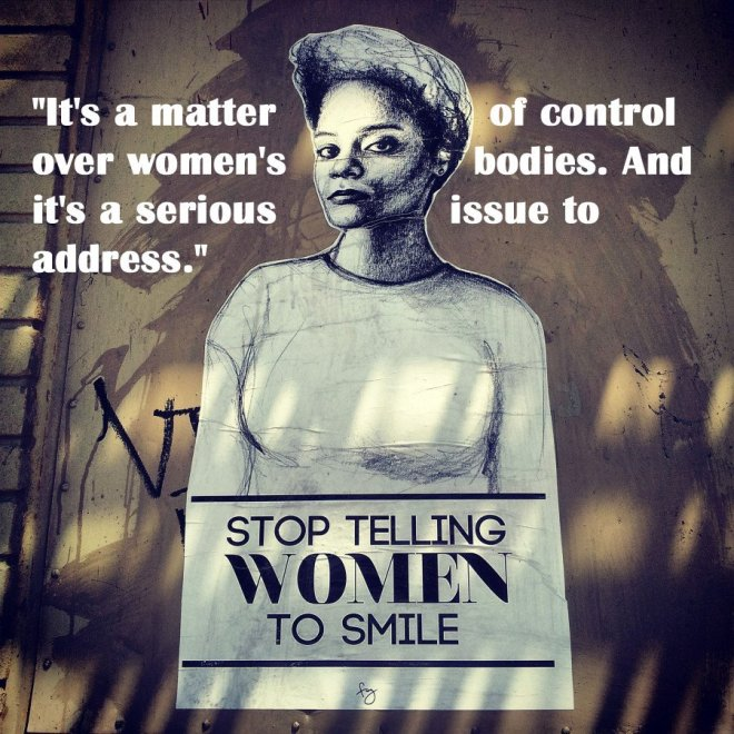 """This image is a photo of artwork by Tatyana Fazlalizadeh, in this case a self-portrait, with the message """"Stop telling women to smile."""" in this photo the artist's words have been added near the top, saying """"It's a matter of control over women's bodies. And it's a serious issue to address."""""""