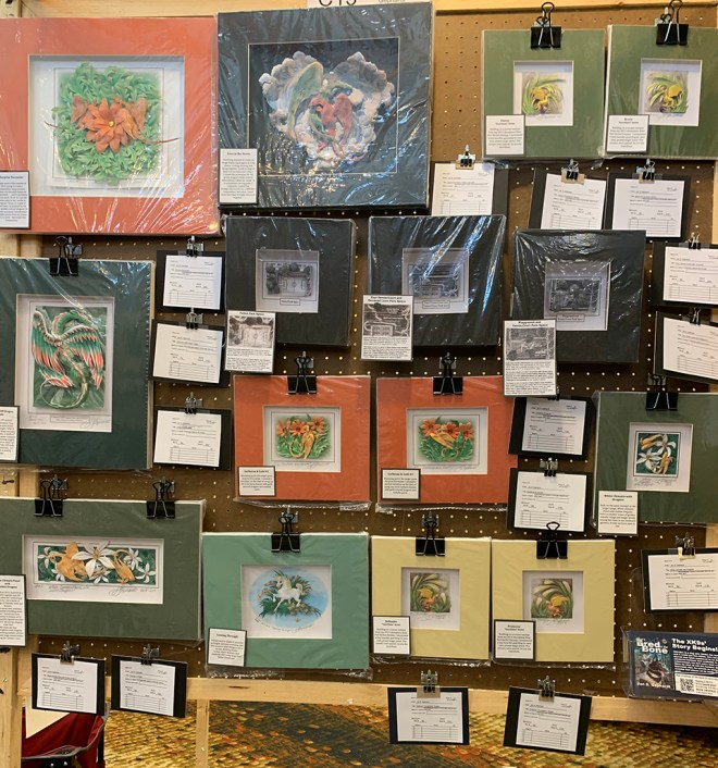 This is a photo of Jan S. Gephardt's art show display panel at SpikeCon in July 2019, featuring her paper sculpture