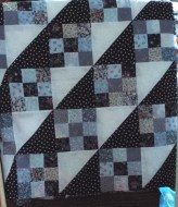 This one has a big star in the middle it is made with polycottons